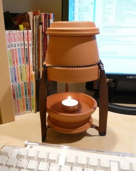 Mantén tu casa caliente con unas macetas, una vela