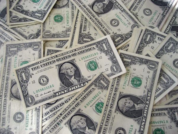 ¿Por qué el símbolo $ representa al dólar?
